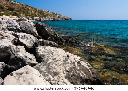 Kolymbia beach with the rocky coast in Greece. - stock photo