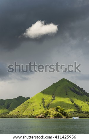 Komodo islands from ocean. Sunny day. A view from the ocean to the Lesser Sunda Isles - stock photo