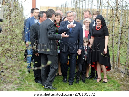 KOMOROW, POLAND - MARCH 08, 2015: President of the Republic of Poland Bronislaw Komorowski during presidential election campaign in apple orchard company - stock photo