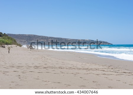Komos beach in Kalamaki situated in the south-central of Crete. The village is close to the Ida mountains, the beach is on the west side between the Messera plain and Matala in the south
