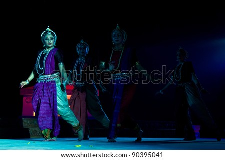 KONARK, INDIA - DECEMBER 04: An unidentified group of lady dancers wears traditional costume and performs Odissi dance at Konark temple on December 04, 2011 in Konark, Orissa, India