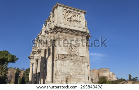 Konstantine triumphal arch in Rome with ruins of temple of Roma and Venus in background, Italy - stock photo