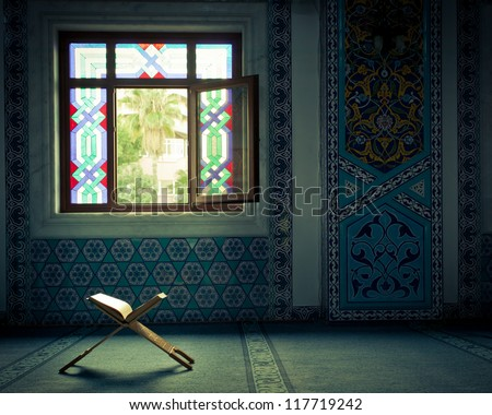 Koran - holy book of muslim, in Turkish mosque under the daylight from the window - stock photo