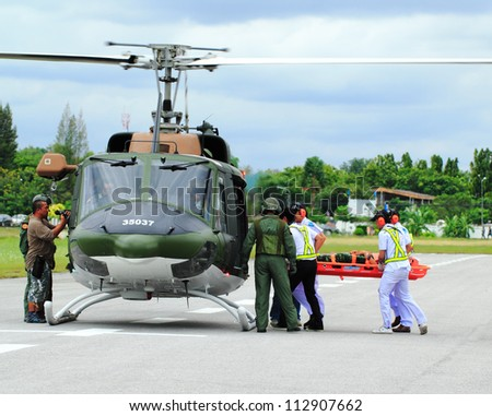 KORAT, THAILAND - SEP 15 : Military Rescue Team(white) pulling cart with wounded person to helicopter in Search and Rescue Exercise(SAREX) on September 15, 2012 in Nakhonratchasima,Thailand - stock photo