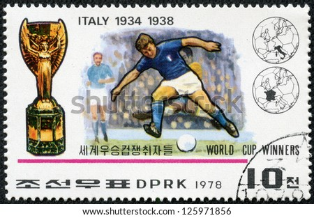 "KOREA - CIRCA 1978: A Stamp printed in North Korea shows the Soccer players, Cup and Emblem with the inscription ""Italy, 1934, 1938"", from the series ""World Cup Winners"", circa 1978 - stock photo"