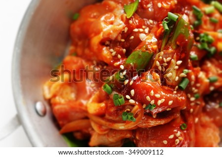 Korean barbecue cooking,marinated spice chicken - stock photo