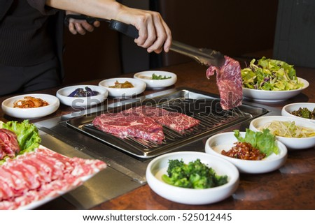 Korean BBQ Raw Beef on the Grill and Pickled Banchan Vegetables