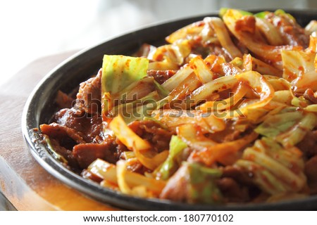 korean beef barbeque with rice cakes and rice on a side and Korean sauce. - stock photo