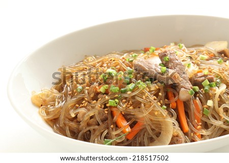 Korean dish known as Japchae made from sweet potato noodles, stir fried in sesame oil with various vegetables - stock photo