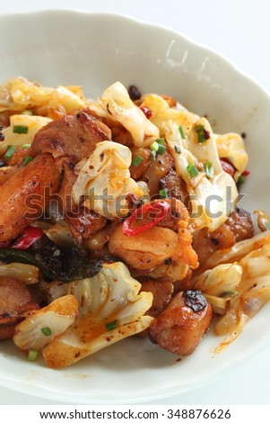 Korean food, marinated chicken and cabbage stir fried