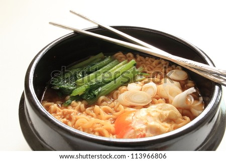 Korean instant spicy ramen noodle with egg and spinach - stock photo