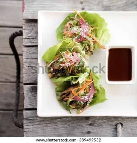 KOREAN PORK LETTUCE WRAP Carrot, Cucumber and Gochujang - stock photo