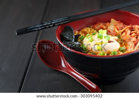 Korean Ramen with Kimchi and seaweed on brown wooden table - stock photo