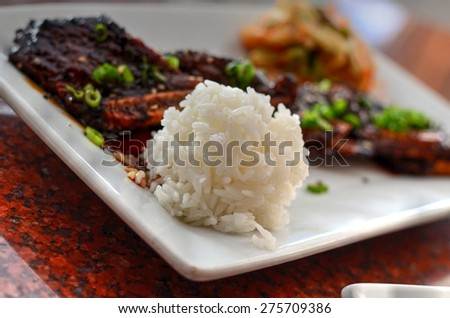 Korean short ribs with rice in the foreground - stock photo