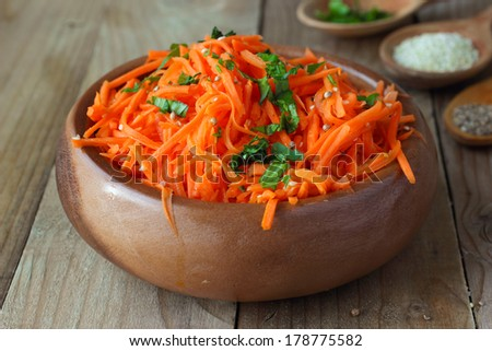 Korean-style spicy carrot salad with coriander and sesame seeds - stock photo