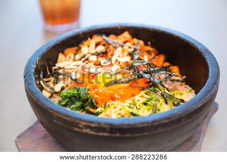 Korean traditional bibimbap in a stone pot - stock photo