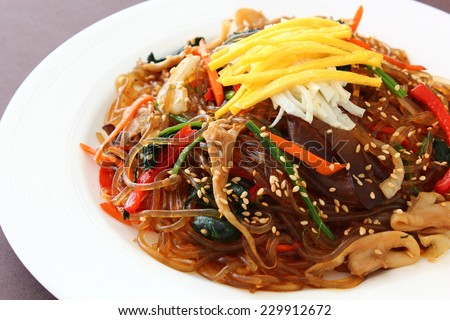 """Korean traditional food. Stir fried glass noodle with soy sauce called """"Japchae / Chapchae"""" - stock photo"""