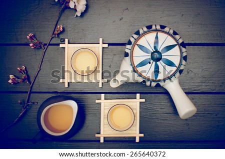 Korean traditional  green tea set for two and a cherry blossom flower - stock photo