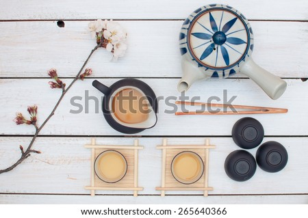 Korean traditional  green tea set with a  cherry blossom flower - stock photo