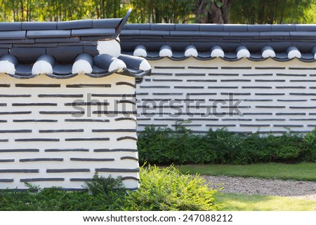 korean wall fence style in the small garden - stock photo