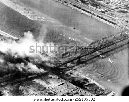 Korean War: U.S. Bombers attack Korean side of Sinuiji Bridge, Korea, 11-29-50. - stock photo