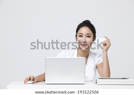 Korean woman working on laptop