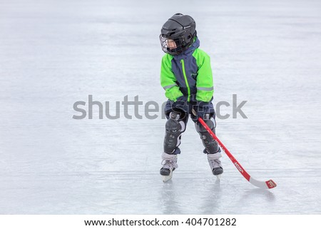 KOROLEV, RUSSIA - MARCH 8, 2016: Young boy during ice hockey training at open air Vympel stadium