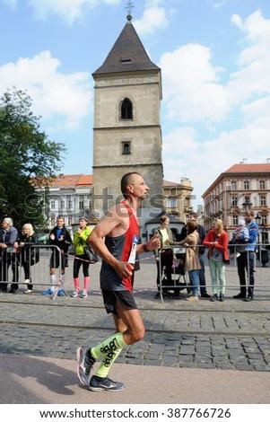 KOSICE, SLOVAKIA - OCTOBER 6, 2015: Uknown runner runs the International Peace Marathon, October 6, 2015 in Kosice, Slovakia. - stock photo