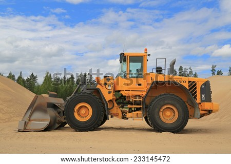 KOSKI TL, FINLAND - JUNE 20, 2014: Volvo L150E wheel loader at a sandpit. During its production years 2002-2007, Volvo L150E was equipped with tree different engines. - stock photo