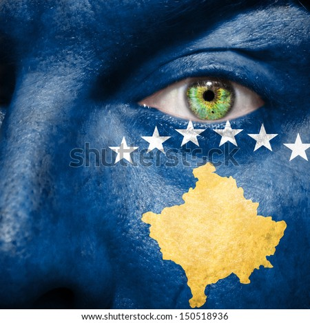 Kosovo flag painted on a man's face to support his country Kosovo