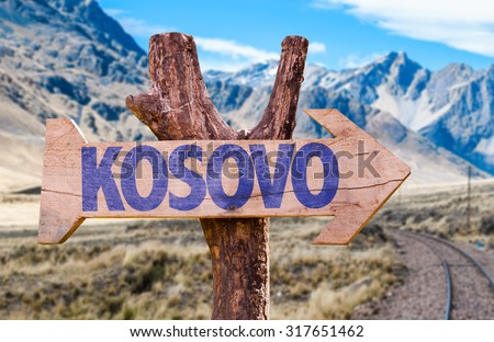 Kosovo wooden sign with Railways Track background - stock photo