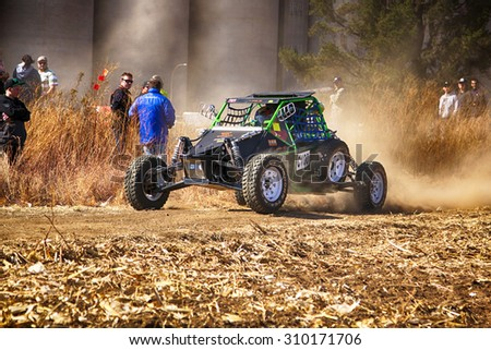 KOSTER, SOUTH AFRICA - July 11:  Africa-Offroad Racing Rally,  on July 11, 2015 at Koster, North West Province, South Africa.  HD - Custom single seater rally buggy kicking up trail of dust on sand - stock photo
