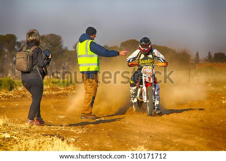 KOSTER, SOUTH AFRICA - July 11:  Africa-Offroad Racing Rally,  on July 11, 2015 at Koster, North West Province, South Africa.  HD - Motorbike stopping at checkpoint on sand track during rally race.  - stock photo