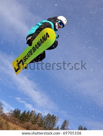 KOSUTKA, SLOVAKIA - JANUARY 23: Juro Bernaro of Slovak republic participates in the Big air January 23, 2011 in Kosutka, Slovakia. - stock photo