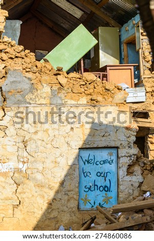 KOT DANDA, LALITPUR, NEPAL - MAY 2, 2015: The school is severely damaged after the 7.8 earthquake that hit Nepal on April 25, 2015. - stock photo