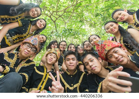 Kota Kinabalu, Malaysia - May 30, 2015: People of various Dusun ethnic in their traditional costume pose for the camera during the Sabah State Harvest festival celeberation in tambunan, Sabah.