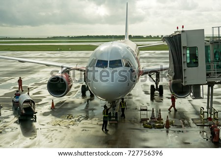 Kota Kinabalu, Malaysia - September 06, 2017: Technicians and mechanic doing a maintenance on airplane before the next departure.