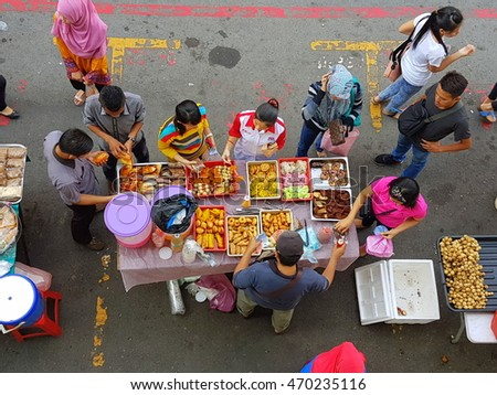 Kota Kinabalu Sabah, Malaysia - August 15, 2016 : Street food seller in Kota Kinabalu. This street is famous for local and tourist to buy food.