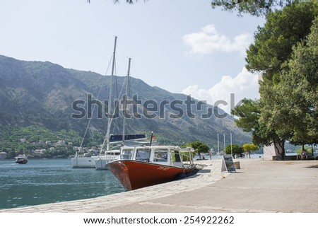 KOTOR, MONTENEGRO - 18 July 2011: Mediterranean old town atmosphere in bay with yachts. Kotor bay of Montenegro.