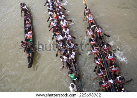 KOTTAYAM, INDIA - AUGUST 29 : Snake boat teams participate in the Thazhathangadi Boat race held on August 29, 2010 in Kottayam, Kerala, India. - stock photo