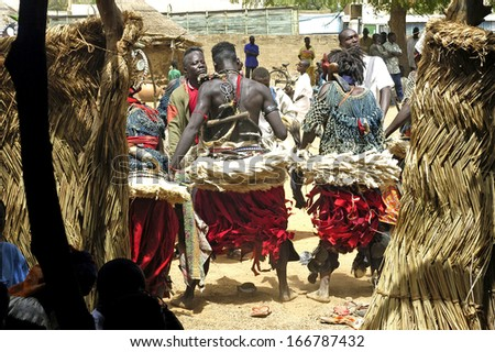 KOUPELA, BURKINA FASO - FEBRUARY 25: Establishment of the new chief of village of Kokemnoure. Dances to honour the new chief with Kokemnoure in king de Koupela, february 25, 2007 - stock photo