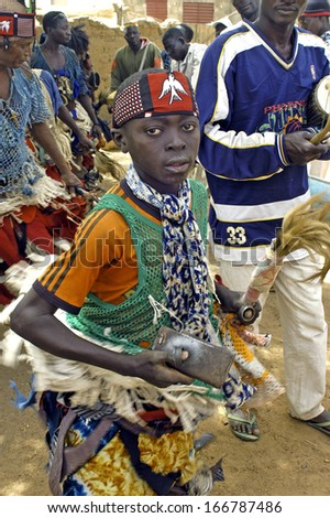 KOUPELA, BURKINA FASO - FEBRUARY 25: Establishment of the new chief of village of Kokemnoure. Portrait of a young warlike dancer, february 25, 2007 - stock photo