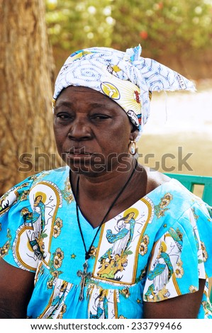 KOUPELA, BURKINA FASO - FEBRUARY 19: Portrait of a woman with a religious dress like Burkina Faso often very religious country, February 19, 2007. - stock photo