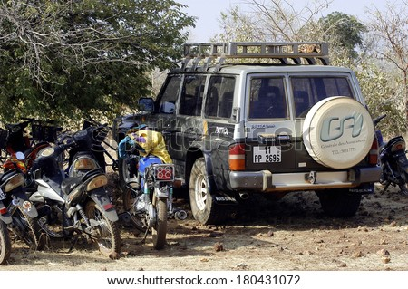 KOUPELA, BURKINA FASO - JANUARY 12: wild golden Koupela mine, the gold diggers come from everywhere to dig, the car of a French researcher gold surrounded motorcycles  African, january 12, 2008.