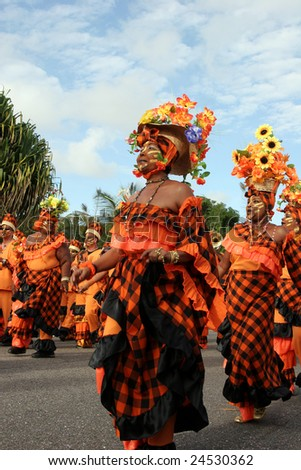 KOUROU, FRENCH GUIANA - JANUARY 28: Participants in the main carnival parade January 28, 2008 in Kourou, French Guiana. The yearly theme contest is ORANGE. - stock photo