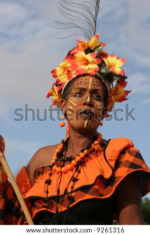 KOUROU, FRENCH GUIANA - JANUARY 28: this woman participates in the main carnival parade January 28, 2008 in Kourou, French Guiana. The yearly theme contest is ORANGE. - stock photo