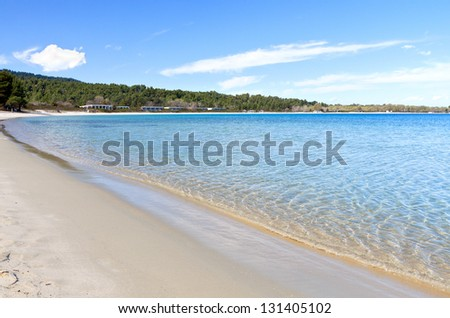Koursaros beach and summer resort at Kassandra of Halkidiki peninsula in Greece - stock photo