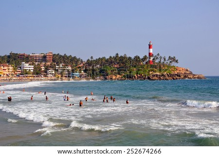 KOVALAM, INDIA  FEBRUARY 1, 2015:  Kovalam is a beach town by the Arabian Sea and has three beaches separated by rocky outcroppings in its 17 kilo meters coastline. - stock photo