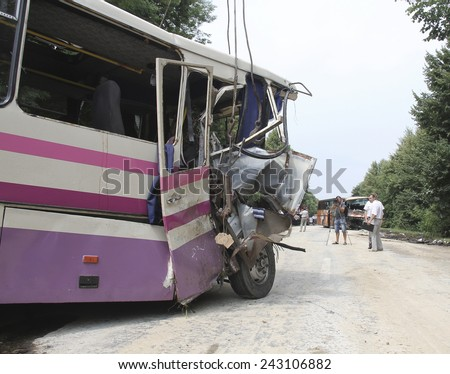 KOVEL, UKRAINE - JULY 11: Scene of bus crash where nine Ukrainian, Belarusian and Bulgarian Tourists died and as many as 30 others were injured July 11, 2013 just outside Kovel, Ukraine. - stock photo