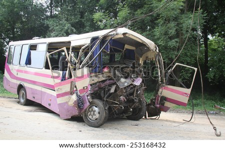 KOVEL, UKRAINE - JULY 11: Scene of bus crash where nine Ukrainian, Belarusian and Bulgarian Tourists were died and as many as 30 others were injured July 11, 2013 just outside Kovel, Ukraine. - stock photo